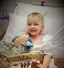 Luke in his hospital bed getting treatment for his chronic disorder